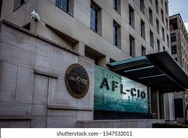 Washington DC—Feb 7, 2019; American Federation of Labor and Congress of Industrial Organizations (AFL–CIO) logo on glass wall at the entrance to their national headquarters building.