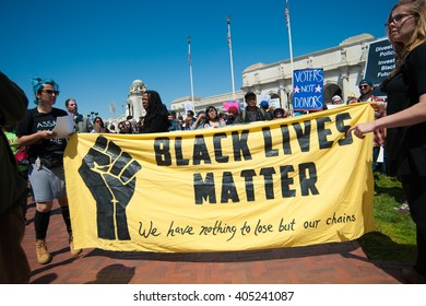 WASHINGTON â?? APRIL 13: Demonstrators protest corruption in politics, support fair elections and support racial justice at an event sponsored by Democracy Spring in Washington, DC on April 13, 2016