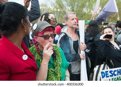 WASHINGTON APRIL 2: A protester smokes marijuana as part of a mass consumption in front of The White House in Washington DC on April 2, 2016