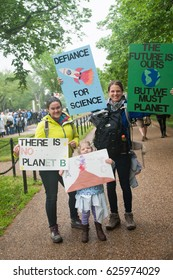 WASHINGTON APRIL 22: Protesters hold signs at the March for Science, which showed support for the role that science plays, in Washington DC on Earth Day, April 22, 2017
