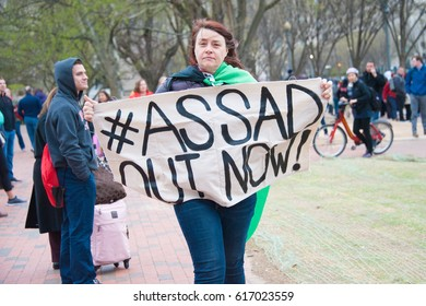 WASHINGTON APRIL 7: A protester holds a signs at a rally against waging war on Syria in Washington DC on April 7, 2017