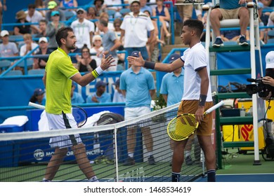 WASHINGTON – AUGUST 1: Marin Cilic (CRO) and Felix Auger-Aliassime (CAN)  after Cilic's win at the Citi Open tennis tournament on August 1, 2019 in Washington DC