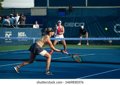 WASHINGTON – AUGUST 3: Maria Sanchez (USA) and Fanny Stollar (HUN) fall in the doubles final at the Citi Open tennis tournament on August 3, 2019 in Washington DC