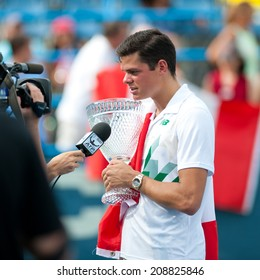 WASHINGTON  AUGUST 3: Milos Raonic is interviewed after defeating fellow Canadian Vasek Pospisil to take the men's title at the Citi Open tennis tournament on August 3, 2014 in Washington DC