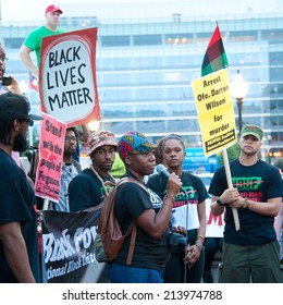 WASHINGTON - AUGUST 30: Marchers rally against racism after the shooting death of Mike Brown in Ferguson, Missouri.  The march took place in Washington, DC on August 30, 2014