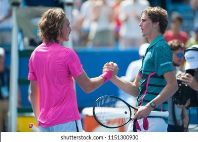 "WASHINGTON – AUGUST 4: Alexander ""Sascha"" Zverev (GER) shakes hands with  Stefanos Tsitsipas (GRE) after Zverev's win at the Citi Open tennis tournament on August 4, 2018 in Washington DC"
