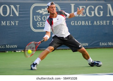 WASHINGTON - AUGUST 4: Lleyton Hewitt (AUS) plays against Alejandro Falla (COL) at the Legg Mason Tennis Classic on August 4, 2010 in Washington. Hewitt retired the match due to a calf injury.