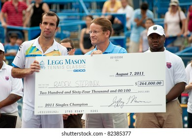 WASHINGTON - AUGUST 7: Radek Stepanek receives his check after defeating Gael Monfils (FRA, not pictured) to become the champion of the Legg Mason Tennis Classic on August 7, 2011 in Washington.