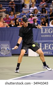 WASHINGTON - AUGUST 7: Tomas Berdych (CZE) aims for the ball at the Legg Mason Tennis Classic on August 7, 2009 in Washington. Berdych was defeated by John Isner (USA).