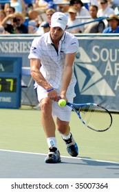 WASHINGTON- AUGUST 9: Andy Roddick (USA) aims for the ball in the championship match of the Legg Mason Tennis Classic August 9, 2009 in Washington. Roddick was defeated by Juan Martin Del Potro (ARG).