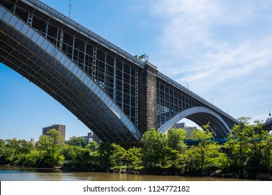 The Washington Bridge is two-hinged Arch bridge over the Harlem River in New York City.The bridge connects the  the boroughs of Manhattan with the Bronx and carries six lanes traffic.