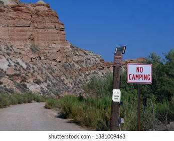 Washington County, Utah--July 2018: Red cliffs and rock formations with roadside signs to the Grafton ghost town, the most photographed ghost town near Zion National Park, Utah.