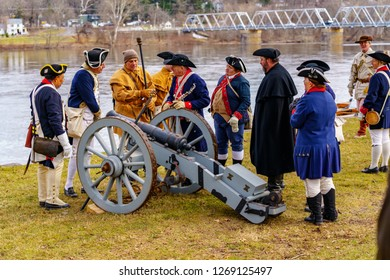 Washington Crossing, PA, USA - December 25, 2018: Reenactors prepare a cannon on Christmas to commemorate General George Washington's crossing the Delaware River in 1776.