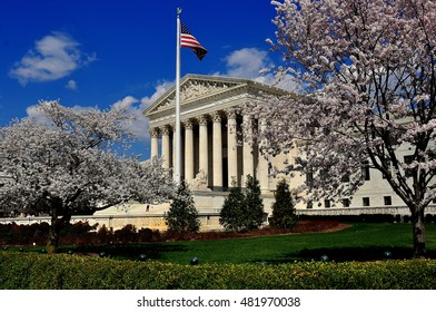 Washington, D -  April 9, 2014:  Flowering cherry tress frame the neo-classical facade of the 1935 United States Supreme Court on First Street SE