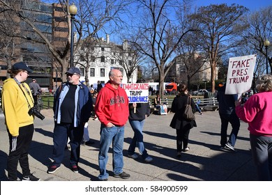 Washington D. C.- February 20, 2017: Editorial. Scenes from a Not my President's Day Rally in Dupont Circle protesting against the policies of Donald Trump. Protesters carried signs, chanted and march