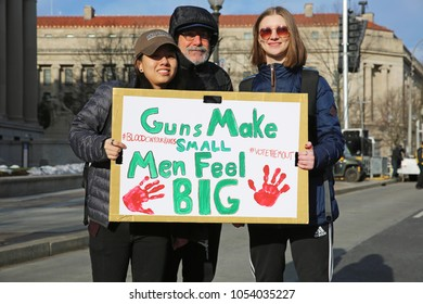 WASHINGTON, D. C., USA - MARCH 24, 2018: Anti-gun protestors demonstrate against deaths in historically huge March For Our Lives protest on Pennsylvania Avenue in Washington, D. C. on March 24, 2018.