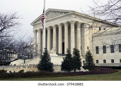 WASHINGTON, DC -19 FEBRUARY 2015- Crowds of mourners and media in front of the Supreme Court building waiting to pay their respects to the late Justice Antonin Scalia who lays in repose.