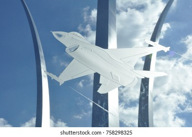 Washington, DC - 4 November 2016: An F-16 etched in glass at the Air Force Memorial with the pillars of the main monument in the background