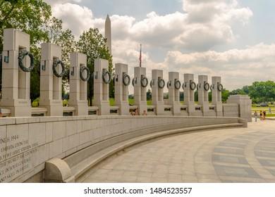 Washington, DC - 7/21/17: Tourists walk past pillars of the World War II Memorial representing the 50 states