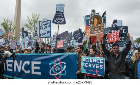 WASHINGTON, DC - APR. 22, 2017: Participants in the March for Science, marching on Constitution Ave. after listening to speakers at Washington Monument on a rainy Saturday Earth Day.