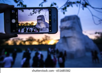 Washington, DC - April 10, 2017: A tourist takes a photo of the Martin Luther King, Jr. memorial.