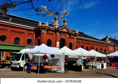 Washington, DC - April 12, 2014:  Vendor's tents and the historic Eastern Market great hall on Seventh Street SE