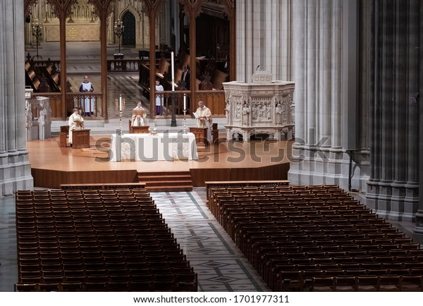 Washington - DC, April 12, 2020: Corona Virus warnings and restrictions meant empty pews at Washington National Cathedral, even on Easter Sunday.