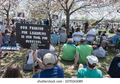 WASHINGTON, DC – APRIL 14, 2018:  Rally at 2018 March for Science. Among demands, a call for public officials to enact evidence-based policy that serves all communities