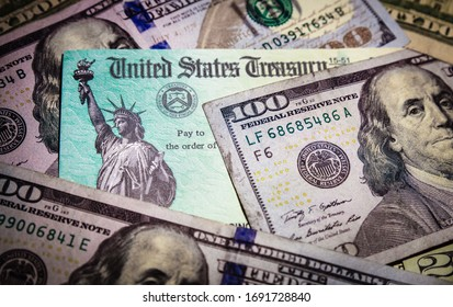 WASHINGTON DC - APRIL 2, 2020: United States Treasury check with US currency. Illustrates IRS tax refund or coronavirus economic impact stimulus payments to taxpayers affected by the pandemic.