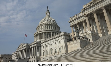 WASHINGTON, DC - APRIL, 2015: US Capitol, or Capitol Building, east side, flag flying.  The Capitol is the seat of Congress, although offices are located in a complex of nearby buildings.