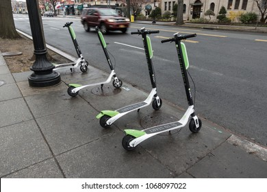WASHINGTON, DC - APRIL 2018: LimeBike dockless electric scooters. LimeBike is one of several dockless bike companies in DC; introduced dockless electric scooters in March 2018,