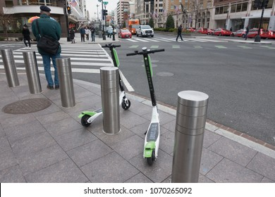 WASHINGTON, DC - APRIL 2018: LimeBike dockless electric scooters downtown. LimeBike is one of several dockless bike companies in DC; introduced dockless electric scooters in March 2018,