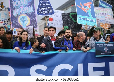 WASHINGTON, D.C. - APRIL 22 2017: Bill Nye leads a group of activists and protesters in a march to the United States capitol during the March for Science.