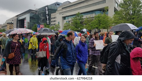 WASHINGTON, DC - APRIL 22, 2017 Protesters march with signs in support of science, scientific research and the environment, during the March for Science on Earth Day.