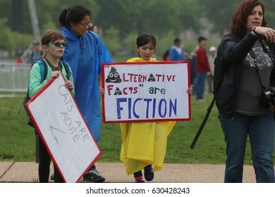 WASHINGTON DC - APRIL 22 2017: Thousands of activists gathered in the Mall on Earth Day to rally & demand that the Trump administration apportion more funds for science.