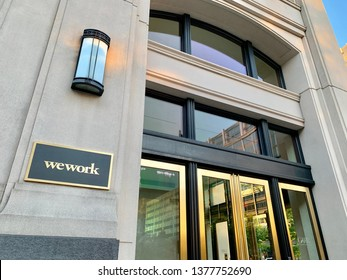 WASHINGTON, DC - APRIL 22, 2019: WEWORK sign at office building location. Wework is an American company offering shared workspaces.