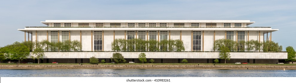 Washington DC - April 24th 2016: John F. Kennedy Center for the Performing Arts in Washington DC, located beside the Potomac and adjacent to the Watergate Complex. Washington Monument on the right.