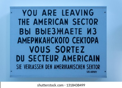 Washington, DC - April 26, 2014: Part of Berlin Wall exhibit in Newseum showing multi-lingual sign