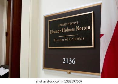 WASHINGTON, DC - APRIL 26, 2019: US HOUSE REPRESENTATIVE ELEANOR HOLMES NORTON DISTRICT OF COLUMBIA - office entrance sign and flag