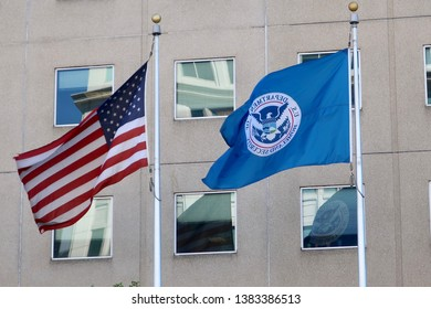 WASHINGTON, DC - APRIL 26, 2019: Flags at USCIS office location, the immigration and naturalization agency within the Department of Homeland Security