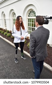 WASHINGTON, DC - APRIL 27, 2018: Brenna Huckaby is interviewed at the White House during the team's welcome. She won gold medals in Snowboarding for the US Paralympics team.
