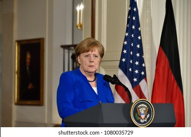 WASHINGTON, DC - APRIL 27, 2018: German Chancellor Angela Merkel takes a question from the German press at a joint press conference with President Donald Trump in the East Room of the White House.