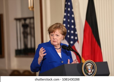 Washington, DC - April 27, 2018: German Chancellor Angela Merkel speaks at a press conference in the East Room of the White House alongside  US President Donald Trump after their meeting.