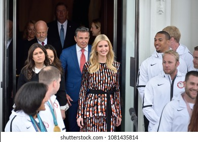 WASHINGTON, DC - APRIL 27, 2018: Ivanka Trump and Sara Huckabee Sanders among others exit the doors of the North Portico as the prepare to Welcome the US Olympic and Paralympic teams to the White Hous