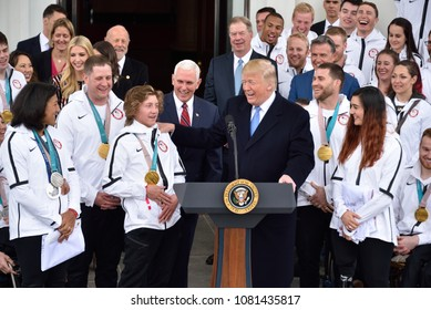 WASHINGTON, DC - APRIL 27, 2018: President Donald Trump jokes with Redmond Gerad who competes in Snowboarding as  he welcomes US Olympic and Paralympic teams to the White House.