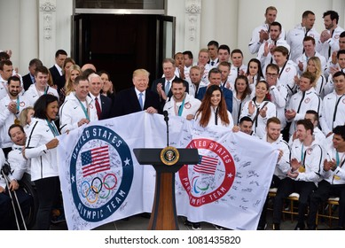 WASHINGTON, DC - APRIL 27, 2018: President Donald Trump welcomes the members of the US Olympic and Paralympic teams to the White House. The signs for both teams are displayed.