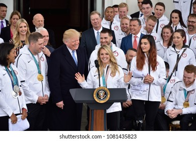 WASHINGTON, DC - APRIL 27, 2018: President Donald Trump speaks with Amanda Kessel who plays Womans Hockey during his welcome of the US Olympic and Paralympic teams to the White House.