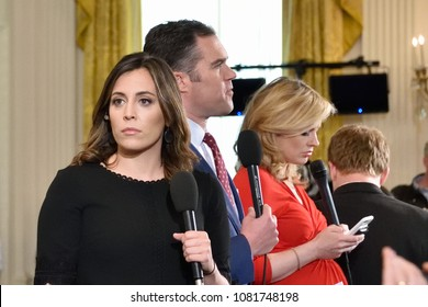 WASHINGTON, DC - APRIL 27, 2018: Journalists from MSNBC, CNN FOX and others prepare for a joint press conference with President Trump and German Chancellor Merkel in the White House East Room.