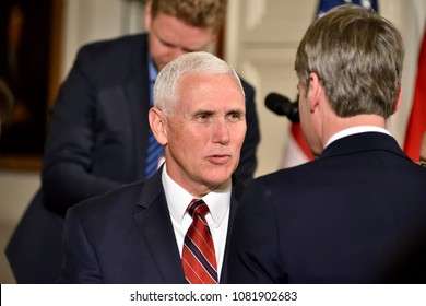 WASHINGTON, DC - APRIL 27, 2018: Mike Pence Vice President of the United States converses as he exits a joint press conference with President Donald Trump and Chancellor Angela Merkel of Germany.