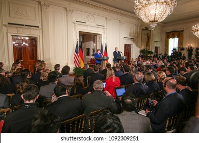 Washington, DC - April 27, 2018: German Chancellor Angela Merkel speaks at a press conference in the East Room of the White House alongside US President Donald Trump.